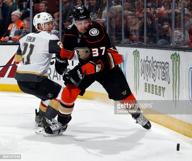 Cody Eakin of the Vegas Golden Knights battles Nick Ritchie of the Anaheim Ducks for the puck on December 27 2017 at Honda Center in Anaheim...