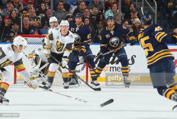Cody Eakin of the Vegas Golden Knights blocks a shot against Benoit Pouliot Justin Bailey and Brendan Guhle of the Buffalo Sabres during an NHL game...
