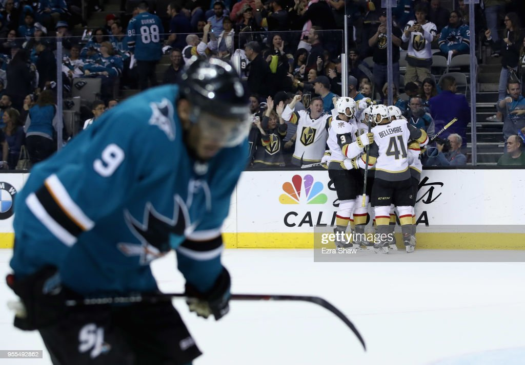 Cody Eakin #21 of the Vegas Golden Knights is congratulated by teammates after he scored an empty net goal late in the third period against the San Jose Sharks during Game Six of the Western Conference Second Round during the 2018 NHL Stanley Cup Playoffs at SAP Center on May 6, 2018 in San Jose, California. Evander Kane #9 of the San Jose Sharks is in the foreground.