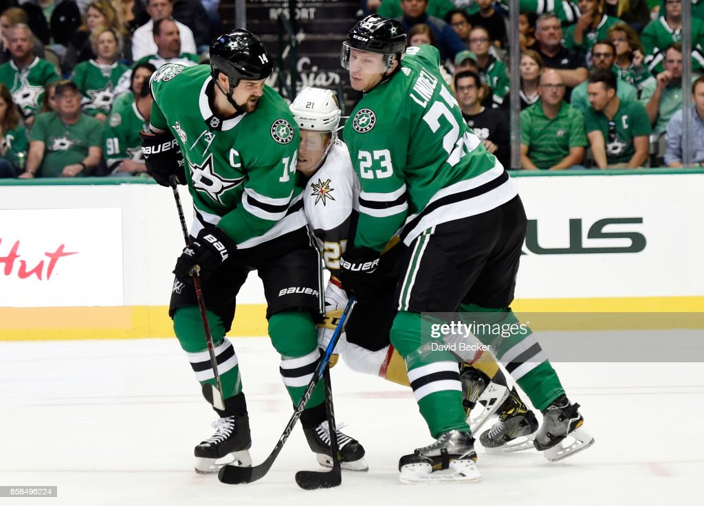Cody Eakin #21 of the Vegas Golden Knights is double teamed by Jamie Benn #14 and Esa Lindell #23 of the Dallas Stars during the season opening game at American Airlines Center on October 6, 2017 in Dallas, Texas. Vegas won 2-1.