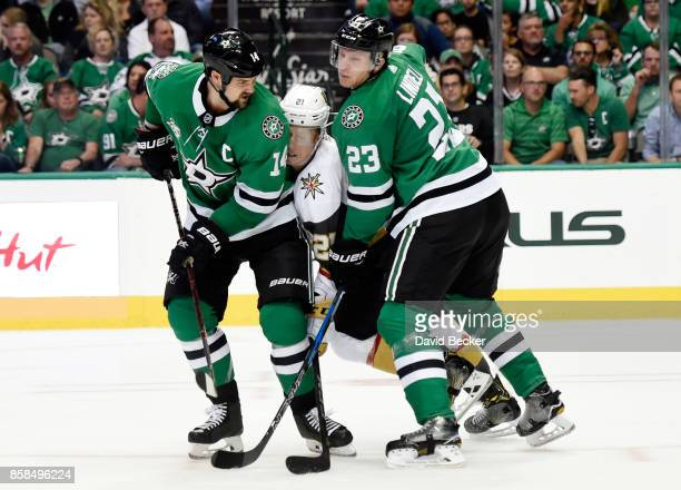 Cody Eakin of the Vegas Golden Knights is double teamed by Jamie Benn and Esa Lindell of the Dallas Stars during the season opening game at American...