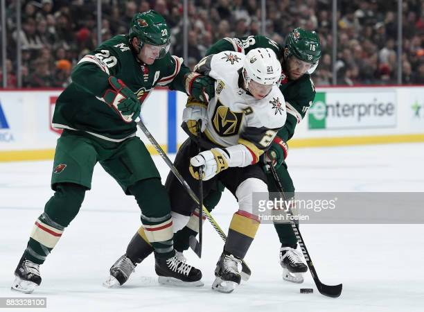 Cody Eakin of the Vegas Golden Knights loses the puck against Ryan Suter and Jason Zucker of the Minnesota Wild during the first period of the game...