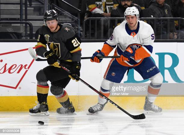 Cody Eakin of the Vegas Golden Knights skates with the puck against Tanner Fritz of the New York Islanders in the first period of their game at...