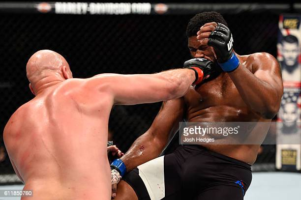 Cody East punches Curtis Blaydes in their heavyweight bout during the UFC Fight Night event at the Moda Center on October 1 2016 in Portland Oregon