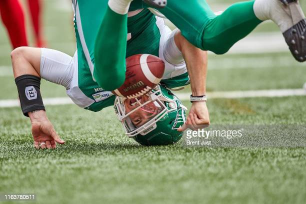 Cody Fajardo of the Saskatchewan Roughriders goes head over heels after scoring a touchdown in the game between the Ottawa RedBlacks and Saskatchewan...