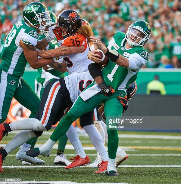 Cody Fajardo of the Saskatchewan Roughriders scores a touchdown in the game between the BC Lions and Saskatchewan Roughriders at Mosaic Stadium on...