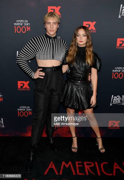 Cody Fern and Billie Lourd attend FX's American Horror Story 100th Episode Celebration at Hollywood Forever on October 26 2019 in Hollywood California