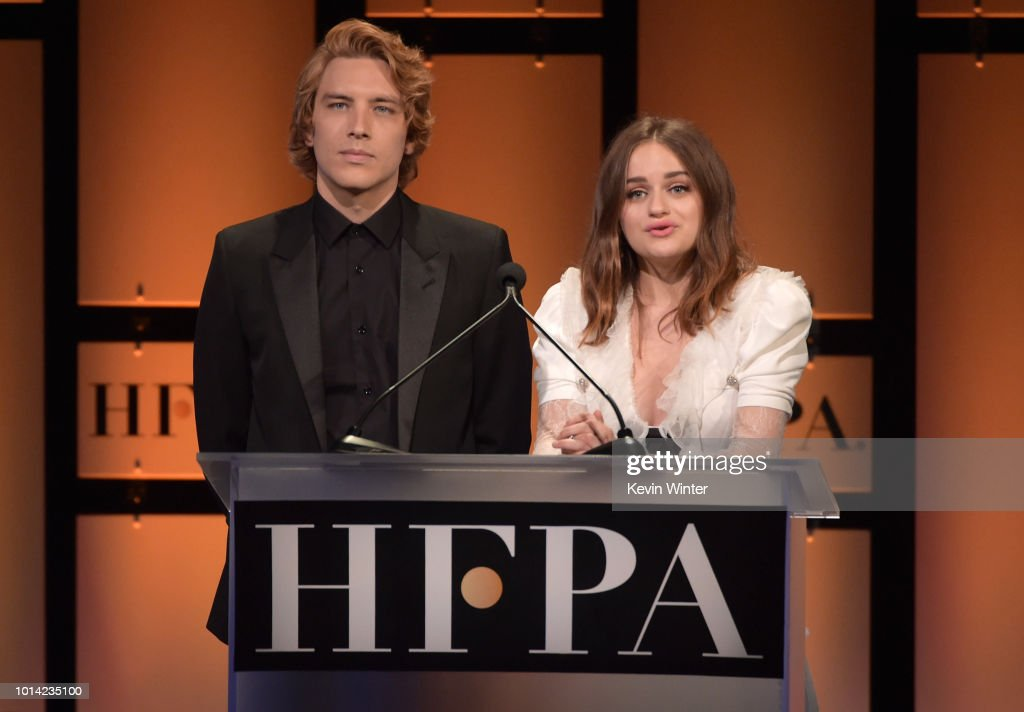 Cody Fern and Joey King speak onstage during the Hollywood Foreign Press Association's Grants Banquet at The Beverly Hilton Hotel on August 9, 2018 in Beverly Hills, California.