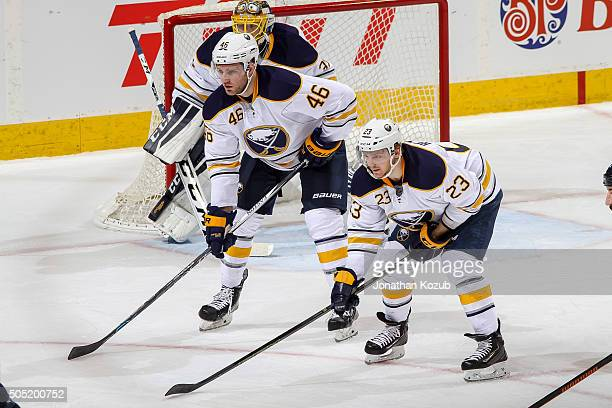 Cody Franson and Sam Reinhart of the Buffalo Sabres get set for a second period faceoff against the Winnipeg Jets at the MTS Centre on January 10...