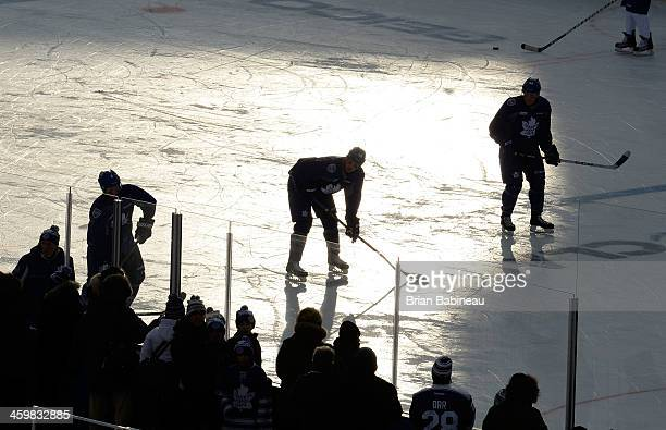 Cody Franson Frazer McLaren and Morgan Rielly of the Toronto Maple Leafs take the ice during 2014 Bridgestone NHL Winter Classic team practice...