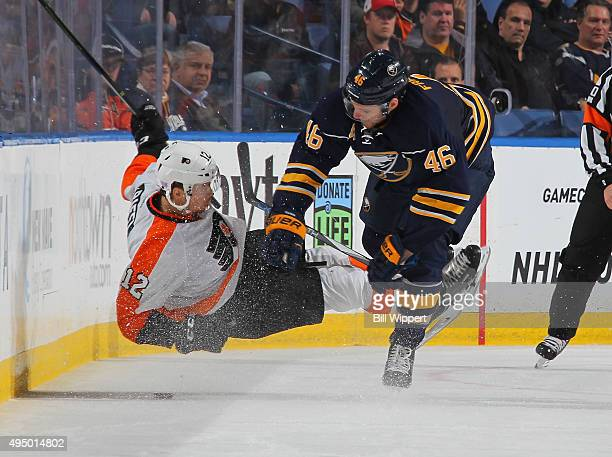Cody Franson of the Buffalo Sabres checks Michael Raffl of the Philadelphia Flyers during an NHL game on October 30 2015 at the First Niagara Center...
