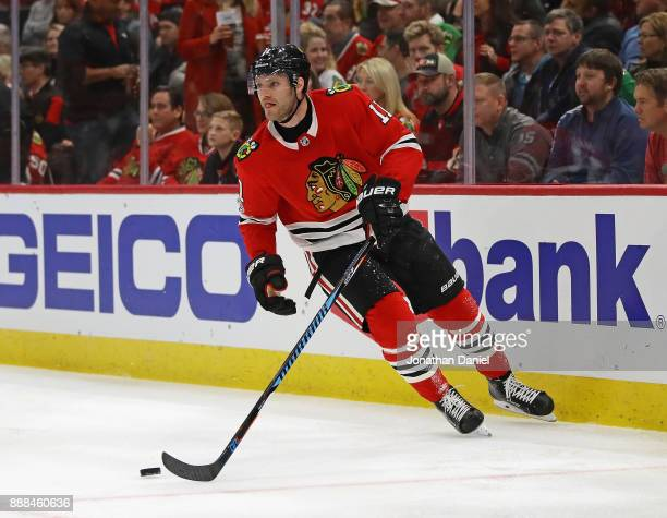 Cody Franson of the Chicago Blackhawks controls the puck against the Dallas Stars at the United Center on November 30 2017 in Chicago Illinois The...