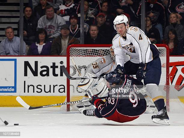 Cody Franson of the Nashville Predators hits Jakub Voracek of the Columbus Blue Jackets at the Nationwide Arena on December 1 2010 in Columbus Ohio...