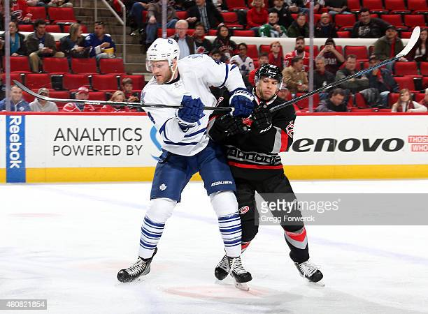 Cody Franson of the Toronto Maple Leafs battles for position with Zach Boychuk of the Carolina Hurricanes during their NHL game at PNC Arena on...