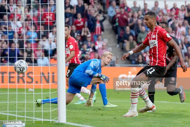 Cody Gakpo of PSV scores the third goal to make it 3-0 during the UEFA Champions League match between PSV v FC Midtjylland at the Philips Stadium on...