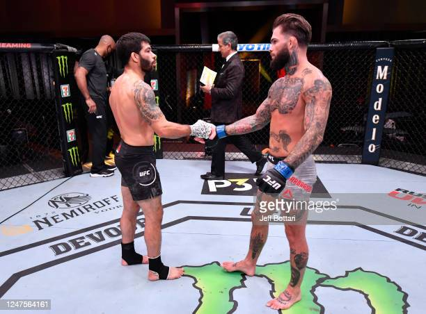 Cody Garbrandt and Raphael Assuncao of Brazil shake hands after their bantamweight bout during the UFC 250 event at UFC APEX on June 06 2020 in Las...