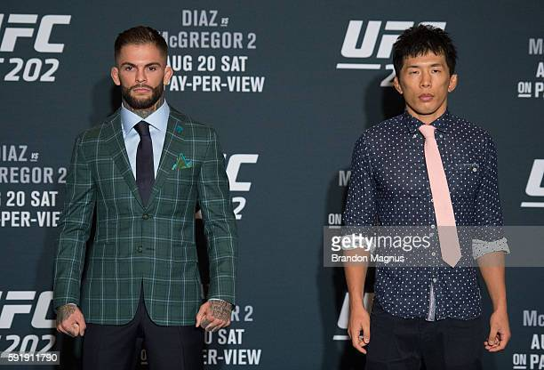 Cody Garbrandt and Takeya Mizugaki pose for a picture during the UFC 202 Ultimate Media Day at the Red Rock Casino Resort on August 18 2016 in Las...