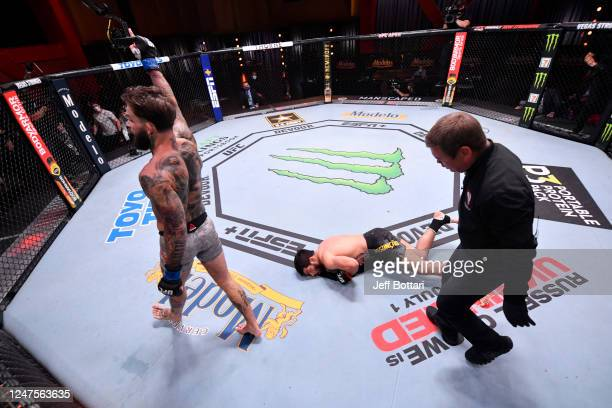 Cody Garbrandt celebrates after his knockout victory over Raphael Assuncao of Brazil in their bantamweight bout during the UFC 250 event at UFC APEX...