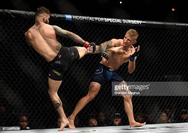 Cody Garbrandt kicks TJ Dillashaw in their UFC bantamweight championship bout during the UFC 217 event inside Madison Square Garden on November 4...