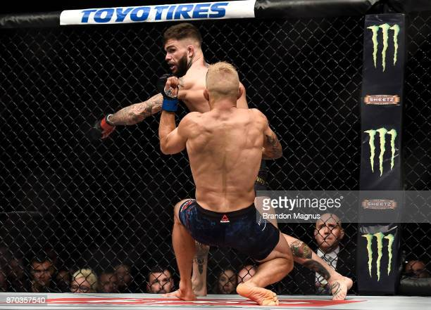 Cody Garbrandt knocks down TJ Dillashaw in their UFC bantamweight championship bout during the UFC 217 event inside Madison Square Garden on November...
