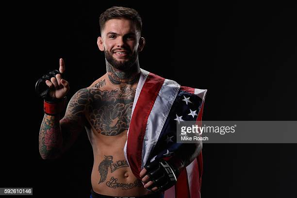 Cody Garbrandt poses for a photo after defeating Takeya Mizugaki of Japan in their bantamweight bout during the UFC 202 event at TMobile Arena on...