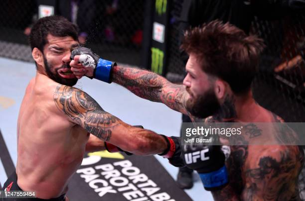 Cody Garbrandt punches Raphael Assuncao of Brazil in their bantamweight bout during the UFC 250 event at UFC APEX on June 06 2020 in Las Vegas Nevada