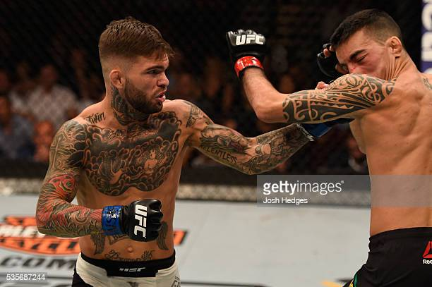 Cody Garbrandt punches Thomas Almeida of Brazil in their bantamweight bout during the UFC Fight Night event inside the Mandalay Bay Events Center on...
