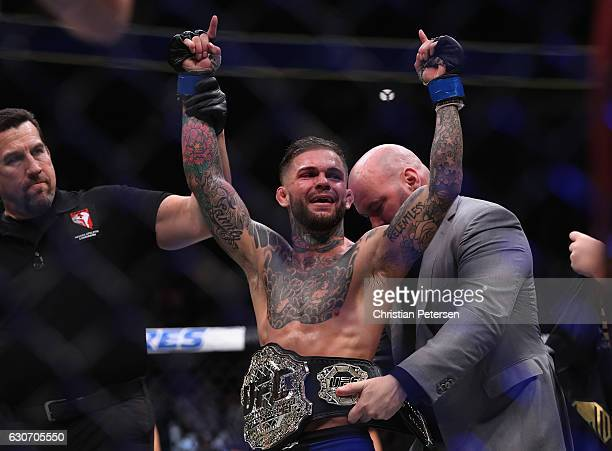 Cody Garbrandt reacts to his victory over Dominick Cruz in their UFC bantamweight championship bout during the UFC 207 event on December 30 2016 in...