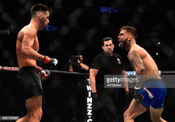 Cody Garbrandt taunts Dominick Cruz in their UFC bantamweight championship bout during the UFC 207 event at TMobile Arena on December 30 2016 in Las...