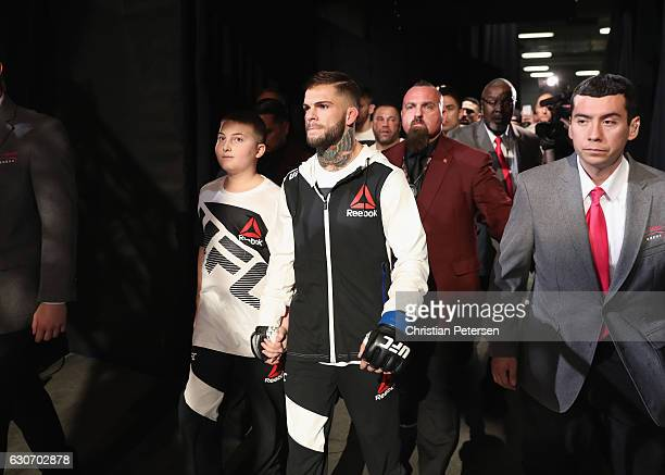 Cody Garbrandt walks to the Octagon to face Dominick Cruz in their UFC bantamweight championship bout during the UFC 207 event on December 30 2016 in...