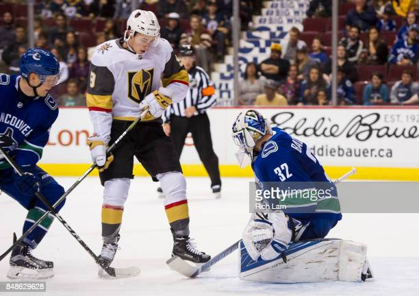 Cody Glass of the Las Vegas Golden Knights looks for a rebound after goalie Richard Bachman of the Vancouver Canucks stops a shot in NHL preseason...