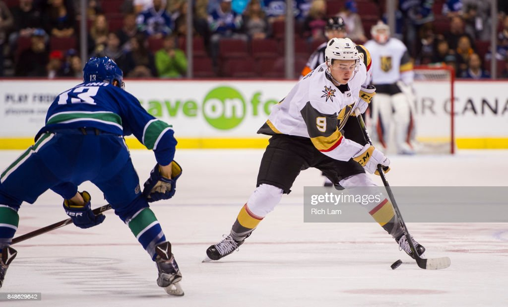 Cody Glass #9 of the Vegas Golden Knights tries to get past Griffen Molino #13 of the Vancouver Canucks in NHL pre-season action on September 17, 2017 at Rogers Arena in Vancouver, British Columbia, Canada.