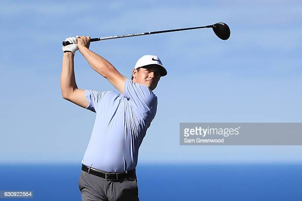 Cody Gribble of the United States plays a shot during practice rounds for the SBS Tournament of Champions at Plantation Course at Kapalua Golf Club...