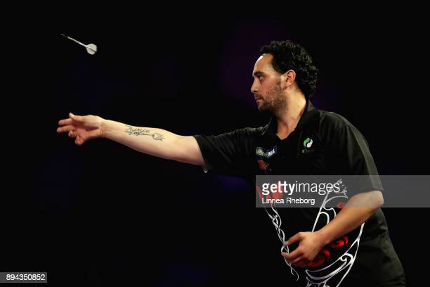 Cody Harris of New Zealand in action during his first round match against Willard Bruguier of United States on day four of the 2018 William Hill PDC...