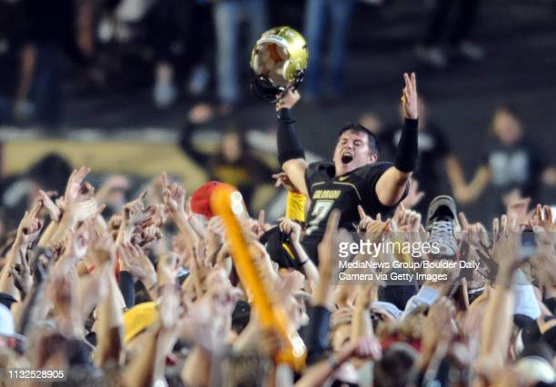 Cody Hawkins is picked up by the fans after the huge win over WVU 1714