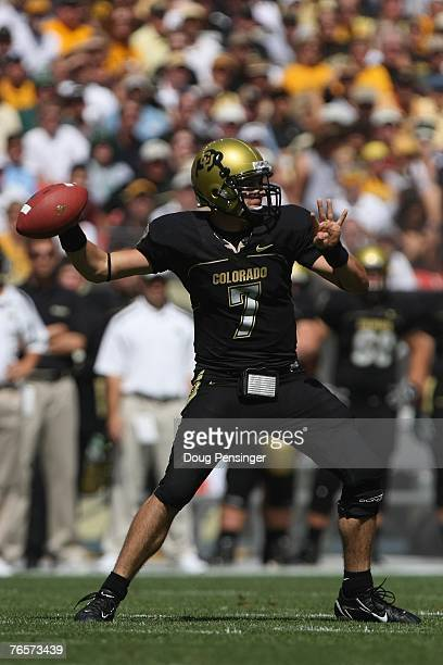Cody Hawkins of the Colorado Buffaloes passes against the Colorado State Rams at INVESCO Field at Mile High on September 1 2007 in Denver Colorado...
