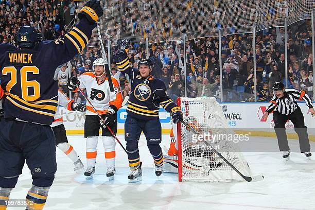 Cody Hodgson of the Buffalo Sabres celebrates his third period goal with teammate Thomas Vanek alongside Jakub Voracek of the Philadelphia Flyers on...