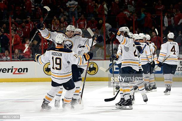 Cody Hodgson of the Buffalo Sabres celebrates with his teammates after scoring the gamewinning goal in a shootout during an NHL game against the...