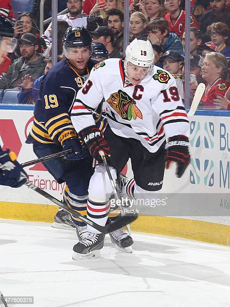 Cody Hodgson of the Buffalo Sabres chases after the puck against Jonathan Towes of the Chicago Blackhawks at First Niagara Center on March 9 2014 in...