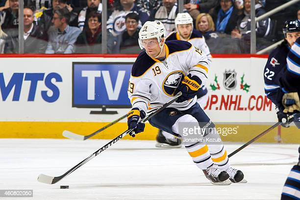 Cody Hodgson of the Buffalo Sabres plays the puck up the ice during first period action against the Winnipeg Jets on December 16 2014 at the MTS...