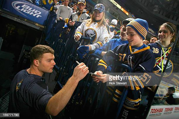 Cody Hodgson of the Buffalo Sabres signs an autograph for a fan prior to playing the Philadelphia Flyers at First Niagara Center on January 20 2013...