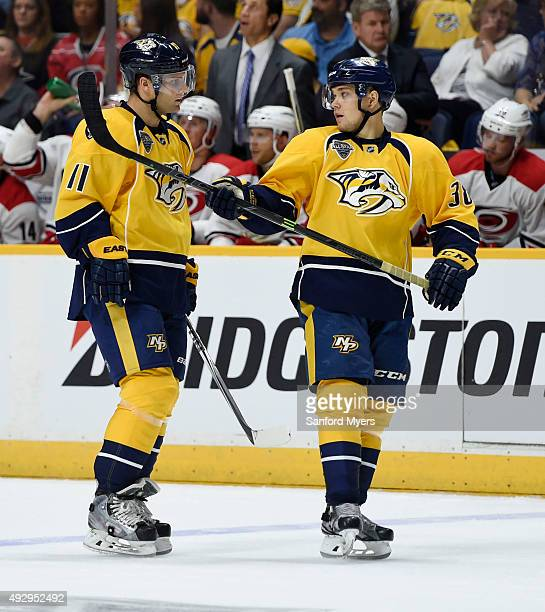 Cody Hodgson of the Nashville Predators left talks with Viktor Arvidsson of the Nashville Predators before a faceoff against the Carolina Hurricanes...