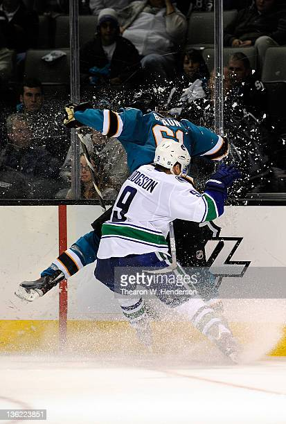 Cody Hodgson of the Vancouver Canucks collides with Justin Braun of the San Jose Sharks at HP Pavilion at San Jose on December 28 2011 in San Jose...