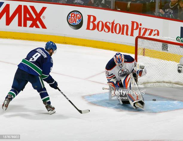 Cody Hodgson of the Vancouver Canucks scores the winning goal on Devan Dubnyk of the Edmonton Oilers in the shootout during their NHL game at Rogers...