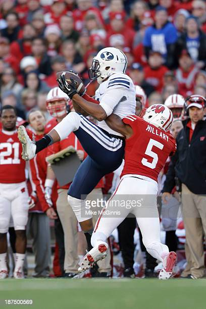 Cody Hoffman of the BYU Cougars makes the catch by the Badgers sideline during the first half against the Wisconsin Badgers during the game at Camp...