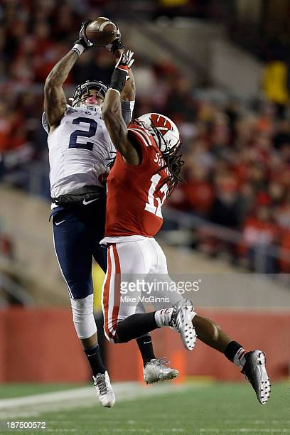 Cody Hoffman of the BYU Cougars makes the catch with Dezmen Southward of the Wisconsin Badgers defending during the second half of play at Camp...