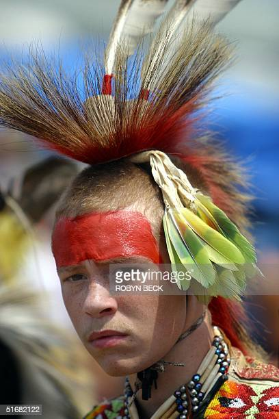 Cody Jacobs of the Lumbee Native American Indian tribe concentrates before performing in a competitive traditional dance at a powwow in Urbana...