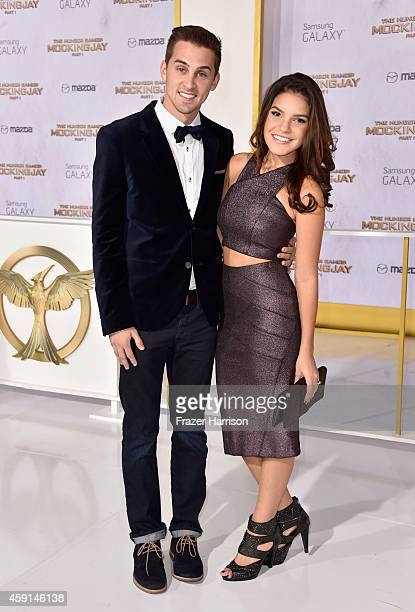 Cody Johns and Alexys Gabrielle attend the premiere of Lionsgate's 'The Hunger Games Mockingjay Part 1' at Nokia Theatre LA Live on November 17 2014...