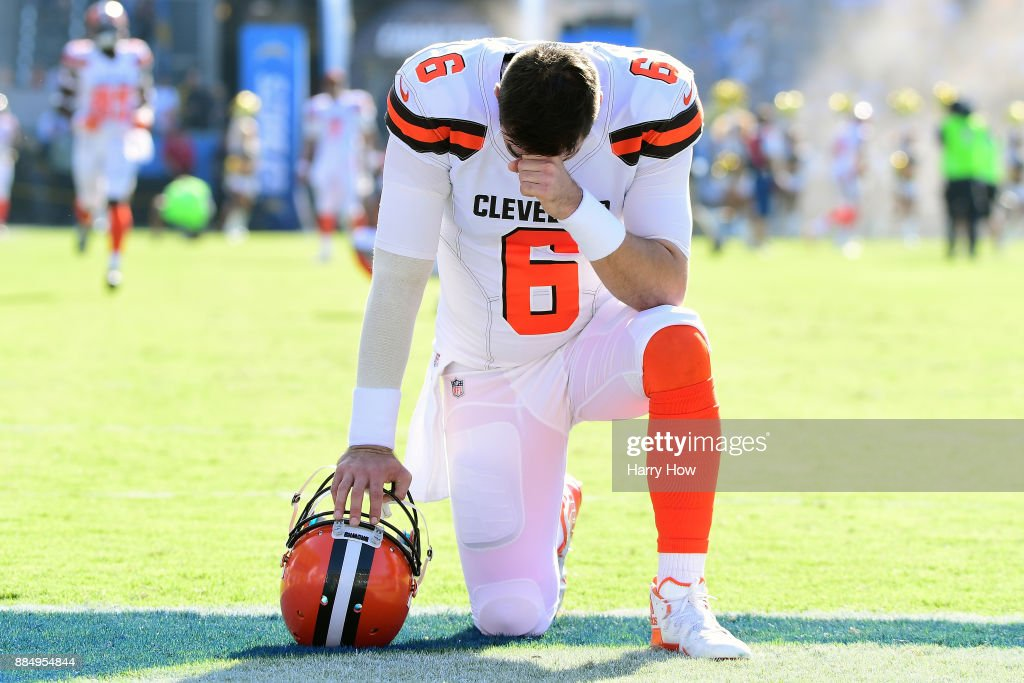 Cody Kessler #6 of the Cleveland Browns kneels and prays prior to the start of the game against the Los Angeles Chargers at StubHub Center on December 3, 2017 in Carson, California.