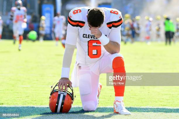 Cody Kessler of the Cleveland Browns kneels and prays prior to the start of the game against the Los Angeles Chargers at StubHub Center on December 3...